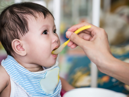 Asian baby eating meal. Stock Photo