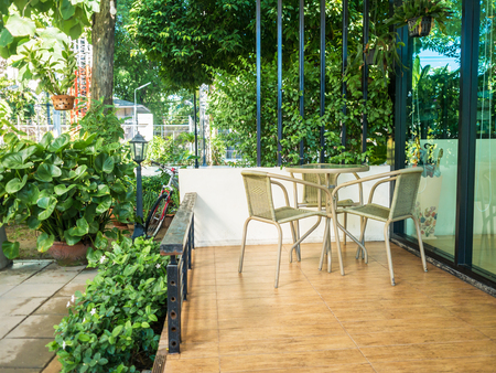 balcony: Wooden dining table at balcony in morning time. Stock Photo