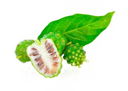 Noni fruits and water drop on white