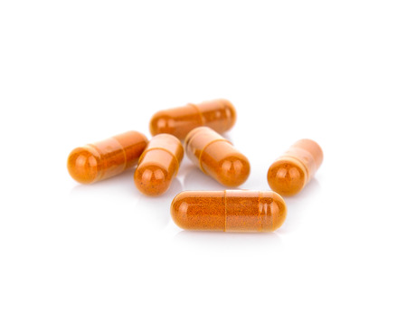 Turmeric capsules isolated Stock Photo