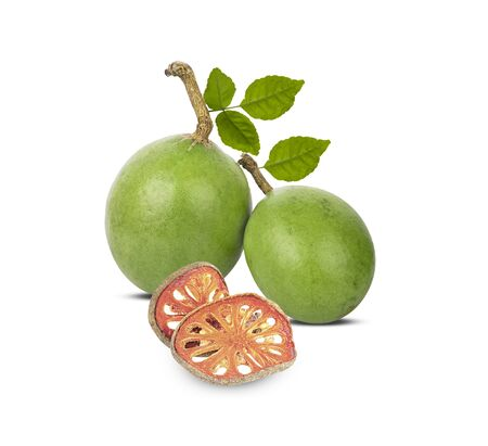 Medicinal Bael fruits on white background