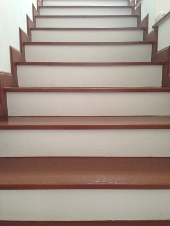 modern: Wooden staircase wade from laminate wood in white modern home. Stock Photo