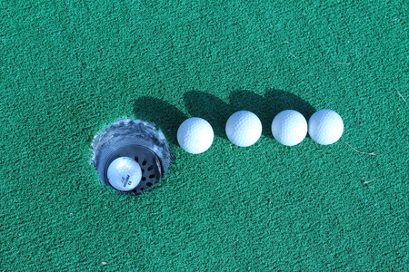 golfball: Wood and golf balls on the green grass