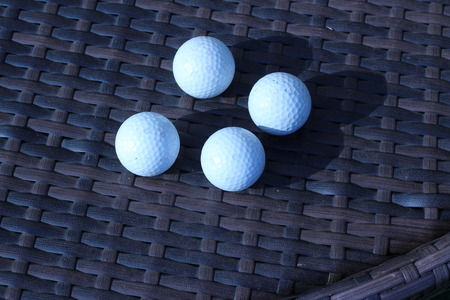 3d ball: Golf ball on a brown background that intertwine