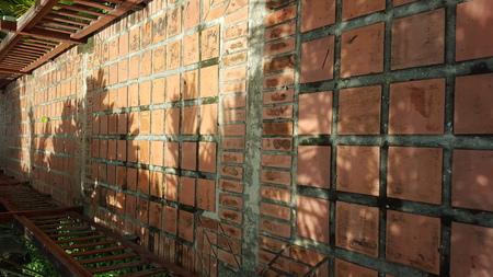 jailbreak: Walkway lined with orange rectangular plate towards the outdoors Stock Photo