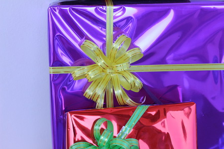 christmas ornamentation: Gift box of multi-colored ribbons arranged beautifully Stock Photo