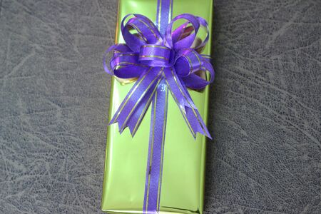 presently: Gift box of multi-colored ribbons arranged beautifully Stock Photo