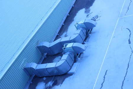 vents: A ventilation duct in a building rooftop in the open air in major cities