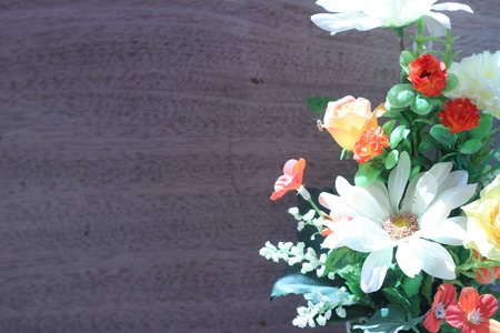 taxonomy: Flowers in a vase on a wooden table old beautiful gray
