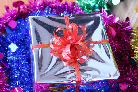 spotless: Gift box of multi-colored ribbons arranged beautifully Stock Photo
