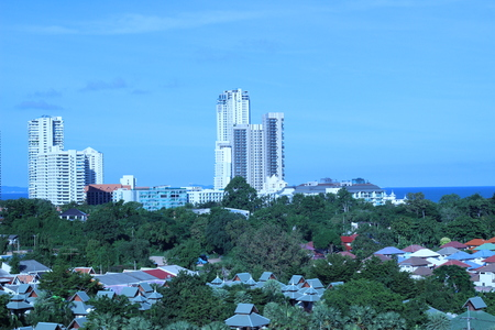 lull: High building by the sea with trees and houses are surrounded (Thailand)