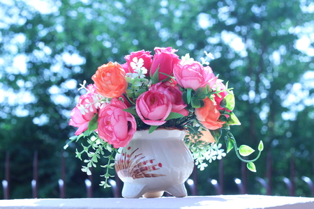 multiplicity: Flowers in a vase multiplicity paint outdoors in the garden Stock Photo
