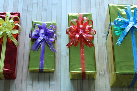 overjoyed: Gift box of multi-colored ribbons arranged beautifully Stock Photo
