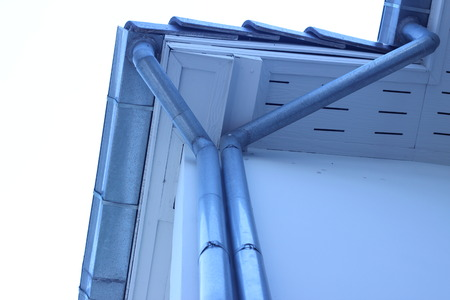 soffit cladding: Rain gutters are attached to the roof and exterior walls