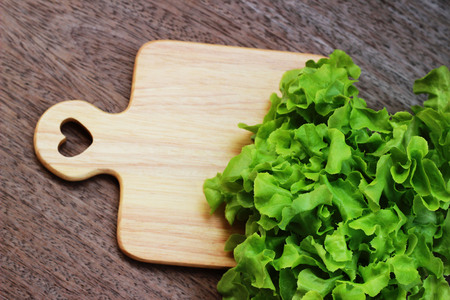 Fresh green lettuce and purple on a brown wooden table Stock Photo