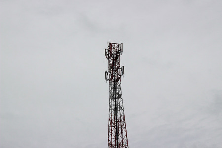 informant: Signal towers in the sky and gray clouds Stock Photo