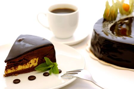 Delicious French bakery.  Chocolate cake with coffe and touch of mint.  Stock Photo - 10319501