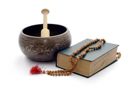 rin gong: Singing bowl, book and wooden rosary isolated on a plain white background. Stock Photo