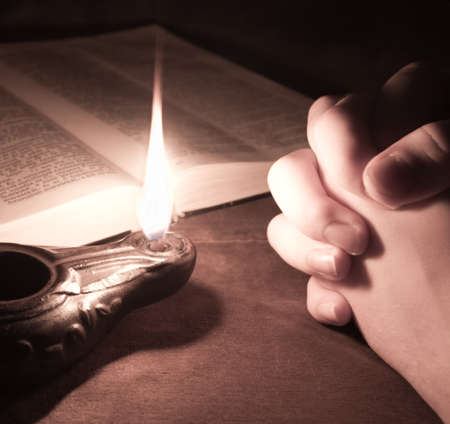 oil lamp: Pray Stock Photo