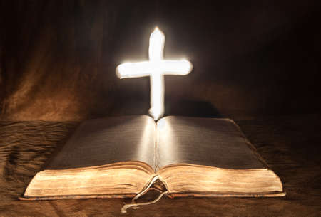 Mysterious Cross above Bible  Stock Photo - 16757398