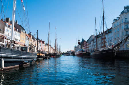 Touristic attraction point, the harbour  Nyhavn  in Copenhagen