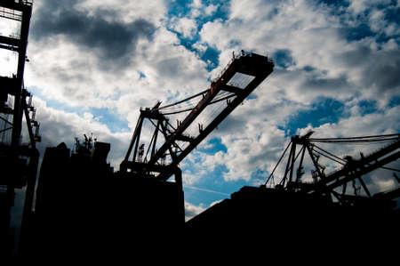 Harbor Crane Silhouettes Stock Photo