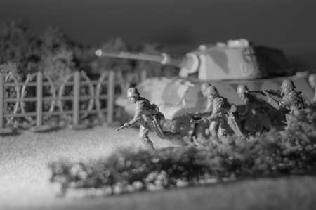 Attacking scene with toy tank and soldiers.