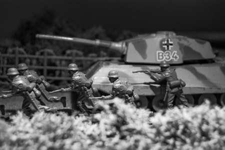 attacking: Attacking scene with toy tank and soldiers.