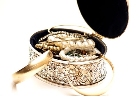 Jewelery box with nice pattern and full of jewelries on white background