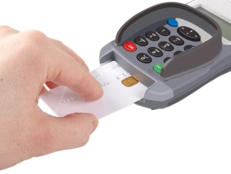 Someone inserting a debit-credit-card with chip into a payment terminal, on white background