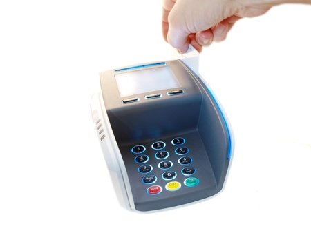 Someone paying with a magnet card, on a payment terminal
