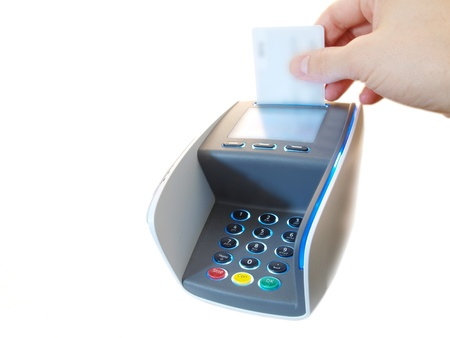 Someone inserting a chip payment card, on a payment terminal Stock Photo