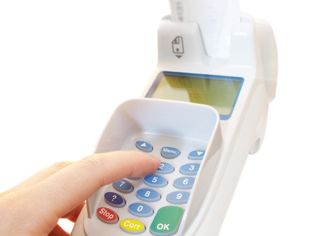 Person at a payment terminal, entering the PIN Stock Photo