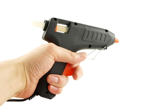 Someone pointing with a glue gun, isolated towards white Stock Photo