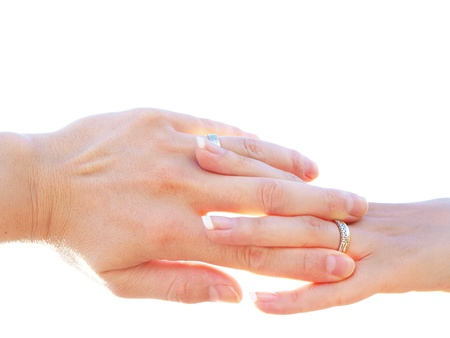 Married couple holding hands towards clear white background