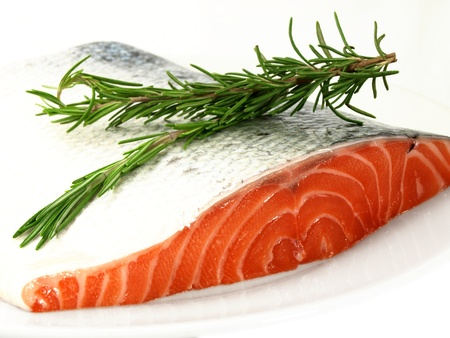 Fresh salmon, big slize, isolated towards white background Stock Photo