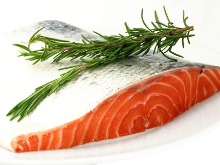 Fresh salmon, big slize, isolated towards white background Stock Photo