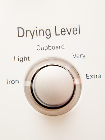 Program button with selections on a washing machine Stock Photo
