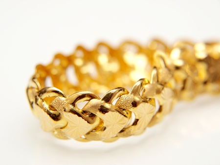 Yellow gold jewelry, isolated towards white background