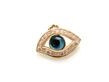 Evil eye with diamonds, and yellow gold, isolated towards white background