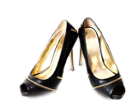 Pair of black high heel shoes, isolated towards white photo