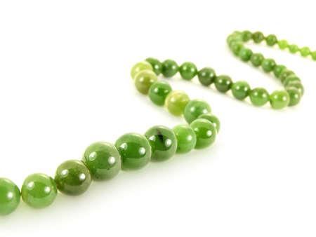 green gemstone: Green gemstone necklace, isolated towards white background