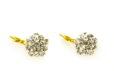 Diamond earrings on yellow gold, isolated towards white background