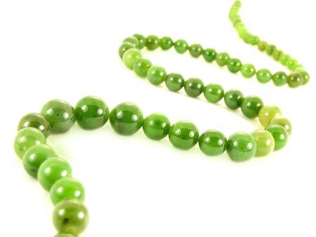 Green gemstone necklace, isolated towards white background Stock Photo - 13040535