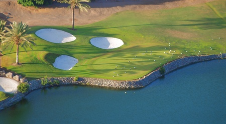 Golf resort, lake, sand and palm-trees