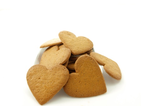 Heart shaped gingerbread, white background photo