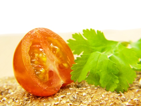 Tomato on cracker and parsley Stock Photo - 13107146