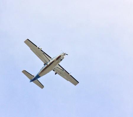 propel: Small propel plane towards blue sky, isolated