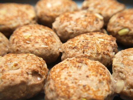 Frying many meatballs, isolated in a frying pan photo