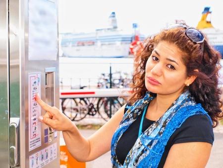 brune: Unhappy brune, female, at ticket vending machine